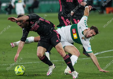 Lucas Boye of Elche CF and Dani Carvajal of Real Madrid CF fight for the ball during La Liga football match played between Elche CF and Real Madrid CF at Martinez Valero stadium on December 30, 2020 in Elche, Alicante, Spain.