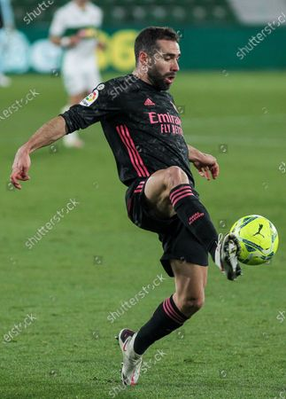 Dani Carvajal of Real Madrid CF controls the ball during La Liga football match played between Elche CF and Real Madrid CF at Martinez Valero stadium on December 30, 2020 in Elche, Alicante, Spain.