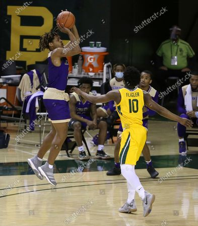 Stock Photo of Alcorn State guard David Pierce (3) shoots over Baylor guard Adam Flagler (10) in the second half of an NCAA college basketball game, in Waco, Texas