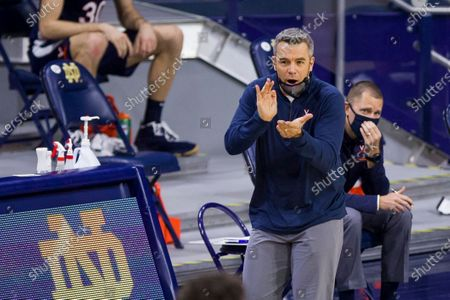 Virginia coach Tony Bennett claps for the team during the second half of an NCAA college basketball game against Notre Dame, in South Bend, Ind. Virginia won 66-57