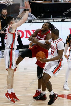 Nebraska's Yvan Ouedraogo, center, is fouled by Ohio State's E.J. Liddell, right, as Kyle Young defends during the first half of an NCAA college basketball game, in Columbus, Ohio