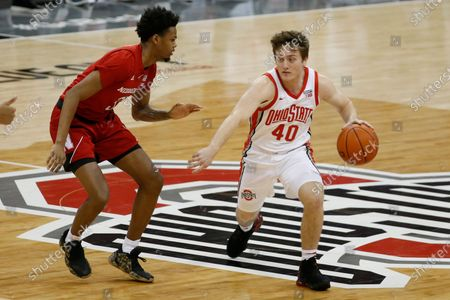 Stock Picture of Ohio State's Jansen Davidson, right, is defended by Nebraska's Elijah Wood during the second half of an NCAA college basketball game, in Columbus, Ohio