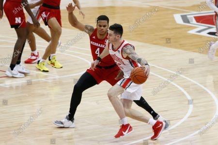Ohio State's Kyle Young, right, drives against Nebraska's Shamiel Stevenson during the second half of an NCAA college basketball game, in Columbus, Ohio
