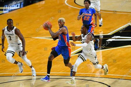 Florida guard Scottie Lewis goes to the basket as Vanderbilt guard Maxwell Evans (3) and guard Trey Thomas, right, defend during an NCAA college basketball game, in Nashville, Tenn