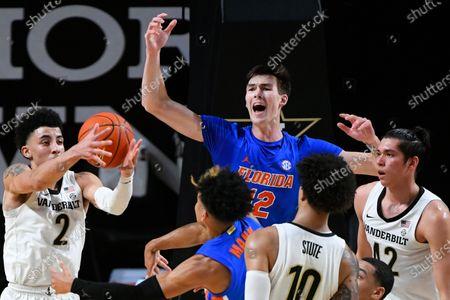Florida forward Colin Castleton reacts as Vanderbilt guard Scotty Pippen Jr. (2) grabs a rebound during an NCAA college basketball game, in Nashville, Tenn