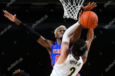 Florida guard Scottie Lewis gets reaches before blocking a shot by Vanderbilt guard Scotty Pippen Jr. during the second half of an NCAA college basketball game, in Nashville, Tenn