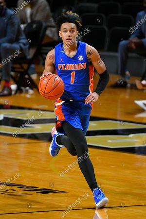 Florida guard Tre Mann brings the ball upcourt during an NCAA college basketball game against Vanderbilt, in Nashville, Tenn
