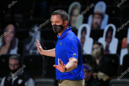 Florida head coach Mike White works the sideline during an NCAA college basketball game against Vanderbilt, in Nashville, Tenn