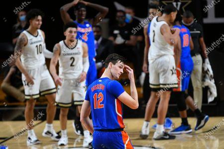 Florida forward Colin Castleton (12) looks back to the bench during an NCAA college basketball game against Vanderbilt, in Nashville, Tenn