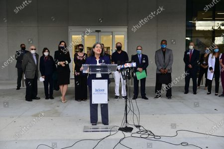 """Daniella Levine Cava, Miami-Dade County Mayor(C), attend a press conference with Dr. Norman G. Einspruch, Edith Einspruch, Danielle Cohen Higgins, Rebecca Sosa, Jose """"Pepe"""" Diaz, Emilio Estefan, Don Steigman, Nat Moore, Luis Alfonso and Venessa Goodnow outside of Lynn Rehab after the vaccination of the elderly with the Pfizer-BioNtech Covid-19, at Jackson Memorial Hospital in Miami, Florida. Jackson Health System began Pfizer COVID-19 vaccinations for people 65 and older in Miami-Dade County.30 Dec 2020"""