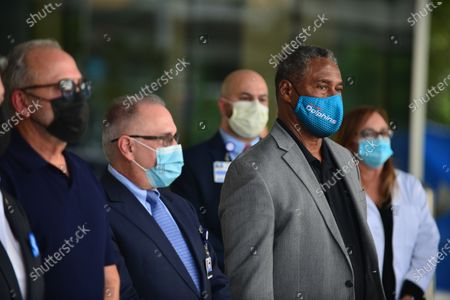 Emilio Estefan, Don Steigman, Chief Operating Officer of Jackson Health system and Nat Moore attend press conference outside of Lynn Rehab after the vaccination of the elderly with the Pfizer-BioNtech Covid-19, at Jackson Memorial Hospital in Miami, Florida. Jackson Health System began Pfizer COVID-19 vaccinations for people 65 and older in Miami-Dade County.