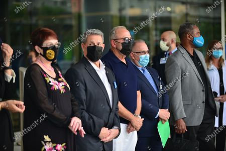"Rebecca Sosa, Miami-Dade County Commissioner, Jose ""Pepe"" Diaz, Miami-Dade County Commissioner, Emilio Estefan, Don Steigman, Chief Operating Officer of Jackson Health system and Nat Moore attend press conference outside of Lynn Rehab after the vaccination of the elderly with the Pfizer-BioNtech Covid-19, at Jackson Memorial Hospital in Miami, Florida. Jackson Health System began Pfizer COVID-19 vaccinations for people 65 and older in Miami-Dade County.