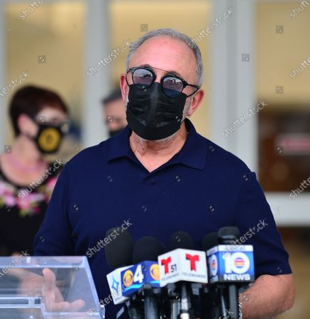 Stock Photo of Music producer Emilio Estefan, attends press conference outside of Lynn Rehab after receiving the vaccination of the  Pfizer-BioNtech Covid-19, at Jackson Memorial Hospital in Miami, Florida. Jackson Health System began Pfizer COVID-19 vaccinations for people 65 and older in Miami-Dade County.