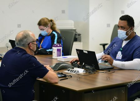 Music producer Emilio Estefan, 67, prepare to receives his first dose of Pfizer-BioNtech COVID-19 vaccine at Jackson Memorial Hospital in Miami, Florida. Jackson Health System began Pfizer COVID-19 vaccinations for people 65 and older in Miami-Dade County.30 Dec 2020