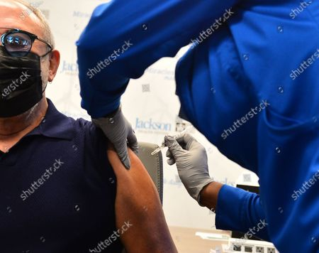Music producer Emilio Estefan, 67, receives a Pfizer-BioNtech COVID-19 vaccine from Nadia Johnson, RN from Jackson Health System, at the Jackson Memorial Hospital in Miami, Florida. Jackson Health System began Pfizer COVID-19 vaccinations for people 65 and older in Miami-Dade County.30 Dec 2020