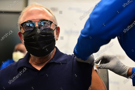 Music producer Emilio Estefan, 67, receives a Pfizer-BioNtech COVID-19 vaccine from Nadia Johnson, RN from Jackson Health System, at the Jackson Memorial Hospital in Miami, Florida. Jackson Health System began Pfizer COVID-19 vaccinations for people 65 and older in Miami-Dade County.