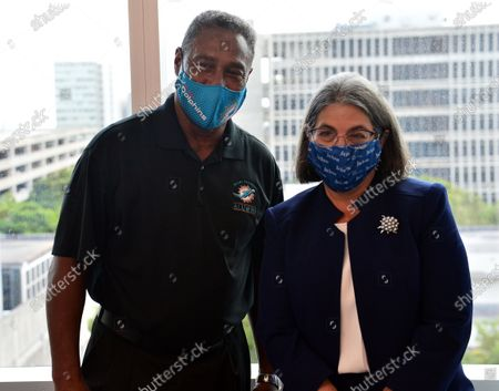 Nat Moore, 69, Former Miami Dolphins and Daniella Levine Cava, Miami-Dade County Mayor, poses for a photo during a Pfizer-BioNtech Covid-19 vaccination campaign for the elderly, at Jackson Memorial Hospital in Miami, Florida. Jackson Health System began Pfizer COVID-19 vaccinations for people 65 and older in Miami-Dade County.30 Dec 2020