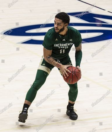 Stock Picture of Moraga, CA U.S.A. Sacramento State Hornets guard Brandon Davis (11) looks to pass the ball during the NCAA Men's Basketball game between Sacramento State Hornets and the Saint Mary's Gaels 45-63 lost at McKeon Pavilion Moraga Calif. Thurman James / CSM