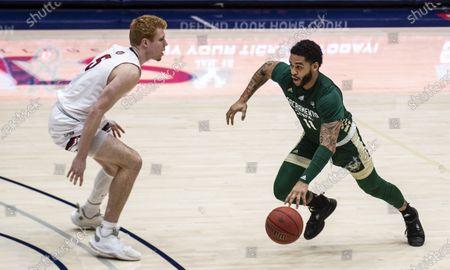 Moraga, CA U.S.A. Sacramento State Hornets guard Brandon Davis (11) drives to the basket during the NCAA Men's Basketball game between Sacramento State Hornets and the Saint Mary's Gaels 45-63 lost at McKeon Pavilion Moraga Calif. Thurman James / CSM