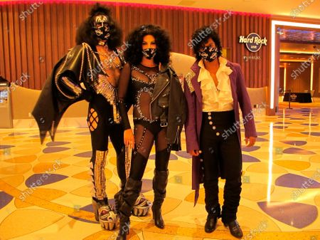 Celebrity impersonators depicting Gene Simmons of Kiss, left, Cher, center, and Prince, right, gather in the lobby of the Hard Rock casino, the first day it reopened after nearly four months of closure during the coronavirus panedmic. How quickly Atlantic City bounces back in 2021 will depend in large part on how quickly the virus is brought under control in the new year