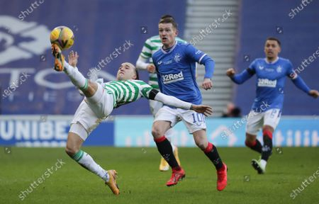 Diego Laxalt of Celtic stretches for the ball ahead of Steven Davis of Rangers
