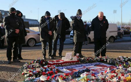 Former Rangers player and manager Ally McCoist, 3rd right, stands at the John Greig statue memorial to the 66 who dies at the 1971 Ibrox disaster