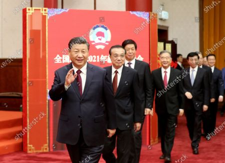 Leaders of the Communist Party of China and the state Xi Jinping, Li Keqiang, Li Zhanshu, Wang Yang, Wang Huning, Zhao Leji, Han Zheng and Wang Qishan attend the New Year gathering held by the National Committee of the Chinese People's Political Consultative Conference (CPPCC) in Beijing, capital of China, Dec. 31, 2020. The leaders also watched a performance at the gathering.