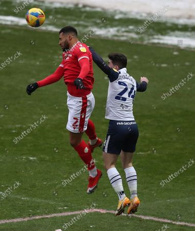 Cyrus Christie of Nottingham Forest and Sean Maguire of Preston North End