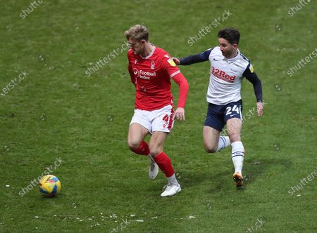Joe Worrall of Nottingham Forest and Sean Maguire of Preston North End