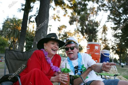 Stock Image of Dawn Wells of Gilligan's Island fame, left, and Chris Erskine, right, talk during a pop-up tiki party
