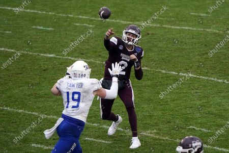 Stock Image of Mississippi State quarterback Will Rogers (2) throws under pressure by Tulsa linebacker Grant Sawyer (19) during the second half of the Armed Forces Bowl NCAA college football game, in Fort Worth, Texas