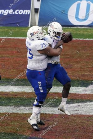 Stock Image of Tulsa running back Corey Taylor II (24) celebrates his touchdown with offensive lineman Dante Bivens (75) against Mississippi State during the second half of the Armed Forces Bowl NCAA college football game, in Fort Worth, Texas