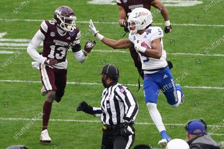 Tulsa wide receiver JuanCarlos Santana (5) runs past Mississippi State cornerback Tyler Williams (13) after a catchduring the first half of the Armed Forces Bowl NCAA college football game, in Fort Worth, Texas