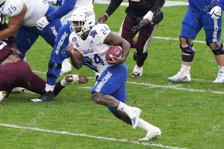 Tulsa running back Corey Taylor II (24) runs the ball against Mississippi State during the first half of the Armed Forces Bowl NCAA college football game, in Fort Worth, Texas