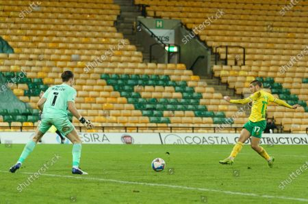 Emi Buendía of Norwich City (17) scores the opening goal past Barnsley Goalkeeper Jack Walton (1)
