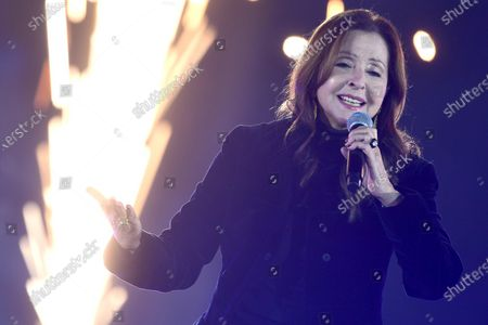 Greek-German singer Vicky Leandros performs during the live broadcast of the New Year's eve show 'Welcome 2021' (Willkommen 2021) by public German TV broadcasting station ZDF, in Berlin, Germany, 31 December 2020. Due to restrictive measures taken to fight the coronavirus crisis, no spectators were allowed to attend the New Year's Eve show at the Brandenburg Gate during the turn of the year 2020/2021. The ZDF decided to sacrifice the usually launched fireworks. Firecracker ban zones have been erected due to infection control reasons to avoid crowds of people. Besides that, casualties of fireworks shall be avoided due to already overcharged hospitals.