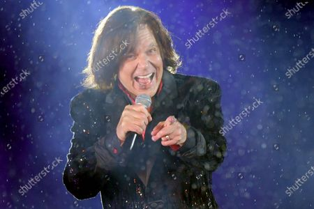 Stock Image of Singer  Juergen Drews performs during the live broadcast of the New Year's eve show 'Welcome 2021' (Willkommen 2021) by public German TV broadcasting station ZDF, at the Brandenburg in Berlin, Germany, 31 December 2020. Due to restrictive measures taken to fight the coronavirus crisis, no spectators were allowed to attend the New Year's Eve show at the Brandenburg Gate during the turn of the year 2020/2021. The ZDF decided to sacrifice the usually launched fireworks. Firecracker ban zones have been erected due to infection control reasons to avoid crowds of people. Besides that, casualties of fireworks shall be avoided due to already overcharged hospitals.