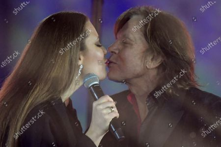 Stock Photo of Singer Juergen Drews (R) and his daughter Joelina perform during the live broadcast of the New Year's eve show 'Welcome 2021' (Willkommen 2021) by public German TV broadcasting station ZDF, at the Brandenburg in Berlin, Germany, 31 December 2020. Due to restrictive measures taken to fight the coronavirus crisis, no spectators were allowed to attend the New Year's Eve show at the Brandenburg Gate during the turn of the year 2020/2021. The ZDF decided to sacrifice the usually launched fireworks. Firecracker ban zones have been erected due to infection control reasons to avoid crowds of people. Besides that, casualties of fireworks shall be avoided due to already overcharged hospitals.