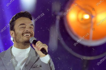 Singer Giovanni Zarrella  performs during the live broadcast of the New Year's eve show 'Welcome 2021' (Willkommen 2021) by public German TV broadcasting station ZDF, at the Brandenburg in Berlin, Germany, 31 December 2020. Due to restrictive measures taken to fight the coronavirus crisis, no spectators were allowed to attend the New Year's Eve show at the Brandenburg Gate during the turn of the year 2020/2021. The ZDF decided to sacrifice the usually launched fireworks. Firecracker ban zones have been erected due to infection control reasons to avoid crowds of people. Besides that, casualties of fireworks shall be avoided due to already overcharged hospitals.