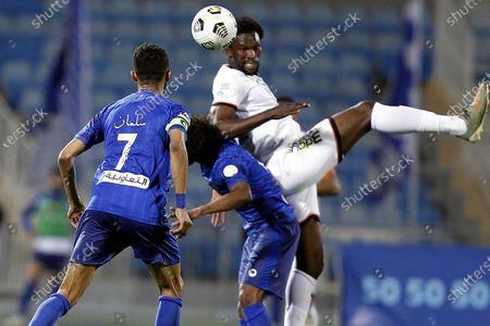 Al-Hilal's players Salman Al-Faraj (L) and Yasir Al-Shahrani (C) in action against Al-Shabab's Makhete Diop (R) during the Saudi Professional League soccer match between Al-Hilal and Al-Shabab at Prince Faisal Bin Fahd Stadium, in Riyadh, Saudi Arabia, 31 December 2020.