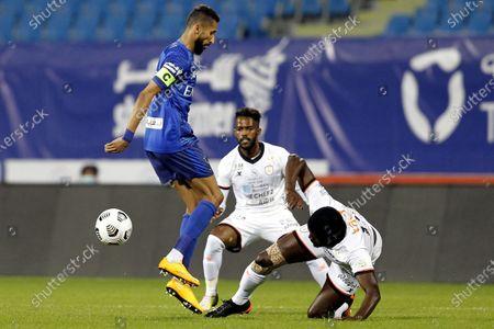 Al-Hilal's player Salman Al-Faraj (L) in action against Al-Shabab's Alfred N'Diaye (R) during the Saudi Professional League soccer match between Al-Hilal and Al-Shabab at Prince Faisal Bin Fahd Stadium, in Riyadh, Saudi Arabia, 31 December 2020.