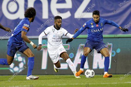 Al-Hilal's player Salem Al-Dawsari (R) in action against Al-Shabab's Nawaf Al-Abed (2-R) during the Saudi Professional League soccer match between Al-Hilal and Al-Shabab at Prince Faisal Bin Fahd Stadium, in Riyadh, Saudi Arabia, 31 December 2020.