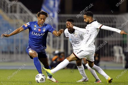 Al-Hilal's player Andre Carrillo (L) in action against Al-Shabab's Hussain Al-Qahtani (R) and Moteb Al-Harbi (2-R) during the Saudi Professional League soccer match between Al-Hilal and Al-Shabab at Prince Faisal Bin Fahd Stadium, in Riyadh, Saudi Arabia, 31 December 2020.