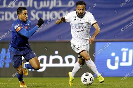Al-Hilal's player Salem Al-Dawsari (L) in action against Al-Shabab's Hussain Al-Qahtani (R) during the Saudi Professional League soccer match between Al-Hilal and Al-Shabab at Prince Faisal Bin Fahd Stadium, in Riyadh, Saudi Arabia, 31 December 2020.