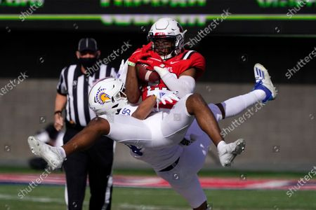 Ball State safety Brett Anderson II (23) intercepts a pass intended for San Jose State wide receiver Isaiah Hamilton during the second half of the Arizona Bowl NCAA college football game, in Tucson, Ariz. Ball State won 34-13