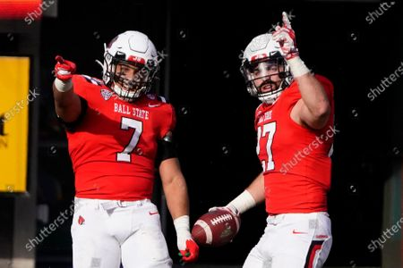Ball State linebacker Jimmy Daw celebrates with Brandon Martin (7) after intercepting a San Jose State pass during the second half of the Arizona Bowl NCAA college football game, in Tucson, Ariz. Ball State won 34-13