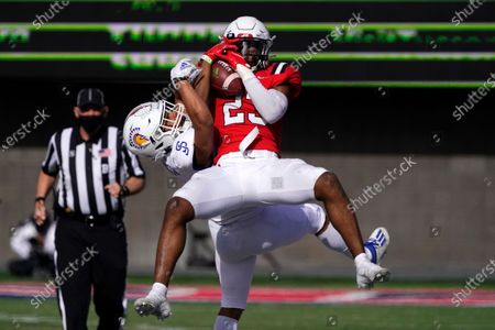 Ball State safety Brett Anderson II (23) intercepts the football intended for San Jose State wide receiver Isaiah Hamilton in the second half of the Arizona Bowl NCAA college football game, in Tucson, Ariz. Ball State won 34-13