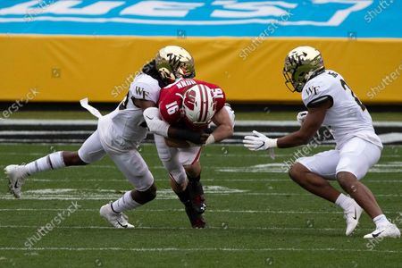 Wake Forest DB Zion Keith (28) tackles Wisconsin WR Jack Dunn (16) during the Dukeâ€s Mayo Bowl football game between the Wake Forest Demon Deacons and the Wisconsin Badgers at Bank of America Stadium in Charlottesville, VA