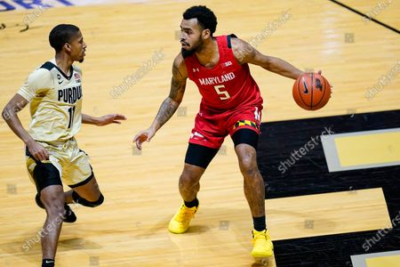 Maryland guard Eric Ayala (5) drives on Purdue guard Isaiah Thompson (11) during the first half of an NCAA college basketball game in West Lafayette, Ind