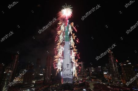 Fireworks illuminate the sky around Burj Khalifa, the tallest building in the world with portrait forHis Highness Sheikh Mohammed bin Zayed bin Sultan Al Nahyan, the Crown Prince of Abu Dhabi and Deputy Supreme Commander of the UAE's Armed Forces , during New Year's 2021 celebrations in the Gulf emirate of Dubai, United Arab Emirates, 01 January 2021.